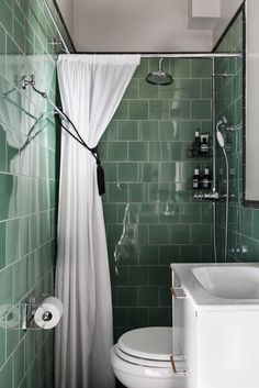 Gravity Home: Tiny Bathroom with Vintage Green Tiles in a Scandinavian Studio Apartment