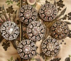 7 large buttons set with rhinestones. Diameter: 31 mm. France (?), Circa 1785
