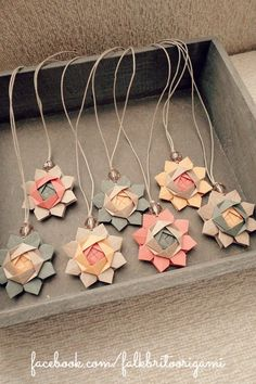 These bookmarks are made from lovely paper flowers, beads, and cord. | Falk Brito Origami                                                                                                                                                                                 More