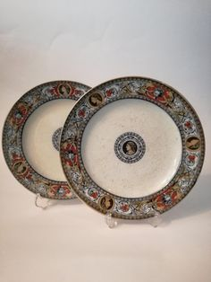 Check out this item in my Etsy shop https://www.etsy.com/listing/479201425/antique-pair-plates-decorative-plates