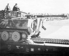 Tiger tank 213 of the schwere Panzer Abteilung 503 on Type SSyms 80 Heavy Flatcar. France 1944
