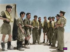 1 Squadron Hurricane pilots, Egypt, summer 1942. Flight commander Captain Tom Rhodes briefing his pilots before an ops during the Alamein battles.  In this period the Germans had air superiority and the SAAF fighter squadrons sustained severe losses. In this group alone all pilots were shot down at some stage (except Salmon), some never to return.