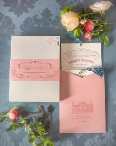 "The stationery featured cheeky wording and whimsical designs. Prim and Pixie designed the pieces, which were letterpressed and tucked into a coral-colored paper sleeve finished off with an illustration of the hotel that inspired it all, the date of the event, and the saying ""love and laughter before happily ever after."" The suite was delivered in boxes boasting a band printed with each recipient's address and a custom postage stamp."
