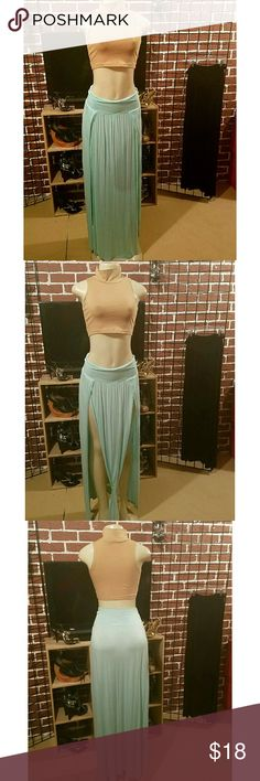 Sexy maxi skirt splits nwot Beautiful long maxi skirt with two slits up the front can be worn  several ways  wear straight down  or tied in a knot so that the slits can be open  or get it altered so that the slits can come down some its your preference very comfortable stretch material I have this skirt in 2 colors mint...(2)S,(1)L and  Black...2x don't forget to pick your color when ordering Skirts Maxi