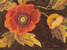Rug Hooking, JG. Love the orange flower shading and the purple in the center