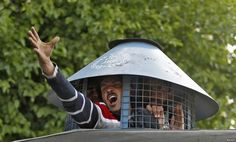 A government employee shouts slogans from inside a police vehicle after he was detained by police during a protest in Srinagar, India, demanding a greater regularization of temporary jobs and a hike in salary.