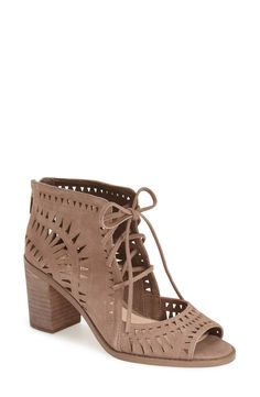 Free shipping and returns on Vince Camuto 'Tarita' Cutout Lace-Up Sandal (Women) (Nordstrom Exclusive) at Nordstrom.com. Eye-catching geometric cutouts call attention to a street-savvy, open-toe lace-upsandal shaped from lustrous suede and set on a chunkystacked heel.