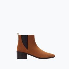 HIGH-HEELED LEATHER BOOTIE WITH ELASTIC SIDE