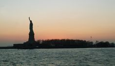 Statue Boat Cruise, New York. This boat trip was just beautiful, watching the sunset behind the Statue of Liberty was a memory I won't forget. Read my review here http://thatideasgirl.com/travel/idea-28-new-york/