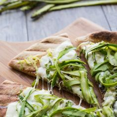A simple springtime grilled pizza made with garlicky leeks, fresh mozzarella, and lightly-seasoned asparagus ribbons.