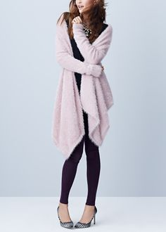 Completing this chic winter look with skinny jeans, a statement necklace and this gorgeous pink eyelash fringe cardigan.
