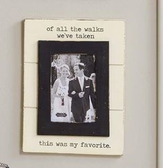 "This distressed wood frame with typewriter font reads ""of all the walks we've taken, this was my favorite"" above and below the photo. It holds a 4 x 6 inch photo and comes with an attached sawtooth ha"