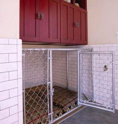 If we really must... Stylish Dog Kennel:  A built-in, chain-link kennel outfitted with two dog beds provides the perfect indoor shelter for your furry friends. Cabinets and cubbies store pet food and other supplies. So much better...can be pretty big depending on where it's built. I hate when people stick their dogs into kennels that are barely bigger than they are! So mean.