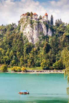 Lake Bled Castle Slovenia | Cliff Castles | Beautiful Castles of the World | Castles on Cliffs | Cliffside Castles | Fairytale Castles | Travel Photography | Fantasy Castles | Beautiful Places | Beautiful Nature | Slovenia Travel | Photo by Eileen10/Bigstock for AdventureDragon.com | #Castles #TravelPhotography #Slovenia #Fairytale