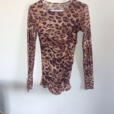 Leopard print sheer top Cute long sleeve lightweight top.  Gathering in front flatters your figure.  Size M/L Tops