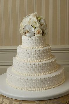 white on white with pearls wedding-cakes