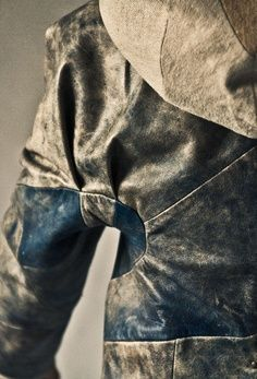 Pieced, intricately constructed suede leather and heavy linen jacket.