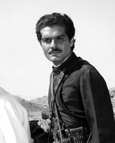 Omar Sharif -- especially Omar in Lawrence of Arabia. I never swoon over guys, but....  SWOON!