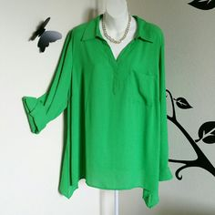 """Kelly Green Chiffon Sharkbite Blouse Beautiful! This is a green blouse with a button down front, long button tab sleeves, collared v-neck, one pocket in front, and a sharkbite hem. Has a plated top in back for flow. Material is polyester.  Size is 2X Bust: Approximately 51"""" Length: Approximately 29""""  New with tags. Style & Co Tops"""