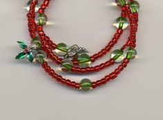 Handcrafted Memory Wire Bracelet - Clear to Green Beads, Red Seed Beads…