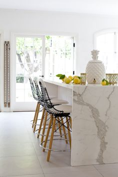 marble island in the kitchen. white.  home decor and interior decorating ideas.