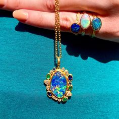Turkish designer, Lika Behar, creates beautiful, handcrafted pieces in rich 24K yellow gold and features a variety of stones, such as this Opal necklace. The vivid array of colors captured is simply stunning.