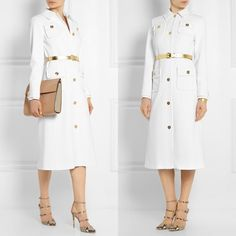 Michael Kors Trench Coat in White Trench coat in white crepe, has gold buttons and gold belt included, new with tags, I am selling in such a low price because it got dirty from the bottom when I was moving and drop it on the floor also there is a slight pink mark on collard, not noticeable when wearing,needs to get dry cleaned, size says 16 but I believe it fits more like a Large, Im between S and M and I liked the oversized look, please don't hesitate to ask!❤️❤️ thank you, retail price…