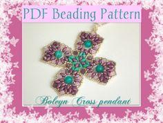 'Boleyn Cross' pendant. The beading pattern is available here: https://www.etsy.com/it/listing/167123156/schema-perline-ciondolo-boleyn-cross-con