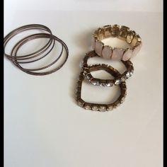 Bundle of bracelets Super cute Stretchy Band Bracelets.. great costume jewelry. 2 Light pink, diamond, (missing one stone) and bronze metal bangles Jewelry Bracelets