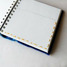 adding pockets to a journal by sewing 2 pages together