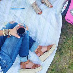Flatform sandals and distressed denim