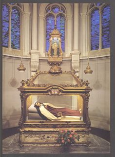Replica of St. Therese at the convent chapel at Le Carmel in Lisieux, France.  Some of her remains have been inserted into the figure which represents her on her death bed. Almost all of the relics are enclosed in a casket underneath the reliquary.