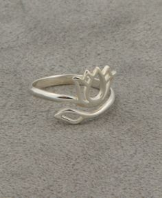 Silver lotus ring adjusts to most sizes. Handmade in Thailand, available at BuddhaGroove.com.