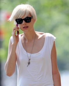 Short blonde hair with a feminine feel of length.  Agyness Deyn wears her platinum long pixie crop well.