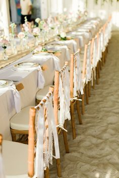 Ribbon on the back of the chairs - Images by Brooke Images - Destination wedding in Florida with a ceremony on the beach & a reception in a Sandbar with Bespoke lace wedding dress, Ted Baker suit & neutral colour palette.