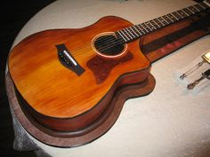 Guitar Cake (Body) by RDPJCakes, via Flickr  This is amazing but I'm sure I won't be able to make this!
