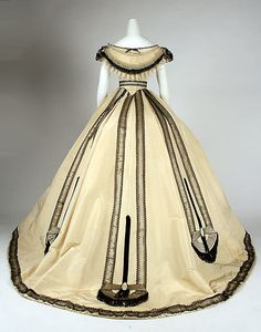 Ivory silk ball gown with black lace and fringe trim (back), by Emile Pingat, French, ca. 1860.