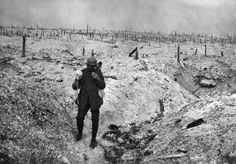 French soldier with a skull on a devastated battlefield of the First World War.