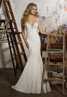 Morilee by Madeline Gardner 'Macy' 8104   Stunning Wedding Dress Made of Allover Vintage Lace with Venice Lace Trim. Dramatic Open Back and Eyelash Lace Hemline add a Touch of Romance. Available in Three Lengths: 55″, 58″, 61″. Colors Available: White, Ivory, Ivory/Light Gold. Shown in Ivory/Light Gold.