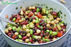 1 can black beans 1 can chickpeas 1 can kidney beans 2 cups shelled edamame 1 small tomato 1 avocado, diced 2 tsp minced garlic 1 tbsp olive oil 1/2 cup chopped fresh cilantro 1 lime Salt and pepper