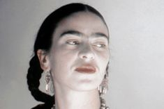 Frida Kahlo, Mexican surrealist and folk art painter, led a colorful life. She often expressed her struggles with pain and disabilities in her work.