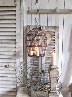 Candles In An Old Bird Cage.