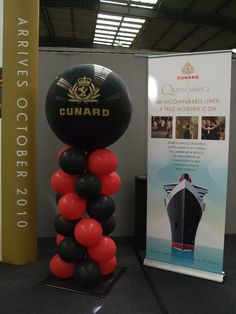 Red and black column topped with 3' printed balloon