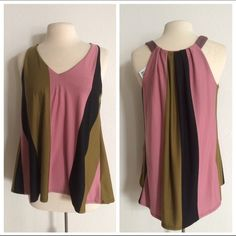 """Puella top Puella (Anthro) top. Size S. 61% polyester/ 33% rayon/ 6% spandex. Slightly high low. Measures 25"""" long in the front and 28"""" in the back. Bust is 36"""". Very flowy! Brand new with tags! No trades. Poshmark onlyI am very open to fair offers! Anthropologie Tops"""