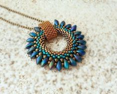 Bronze Blue Green Beaded Pendant with Magatama Beaded by ByElir