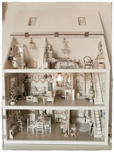 An all white /neutral doll house done up for Christmas. Very calming !