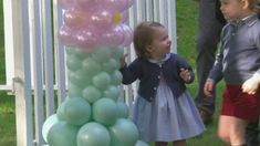 Prince George and Princess Charlotte play with balloons and pet animals in Canada
