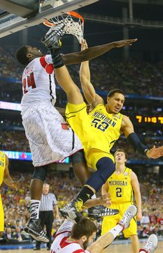 CURTIS COMPTON 040813 ATLANTA: Louisville forward Montrezl Harrell hammers Michigan forward Jordan Morgan under the basket in the second half of the NCAA Division I National Championship on Monday, April 8, 2013, in Atlanta. CURTIS COMPTON/ CCOMPTON@AJC.COM