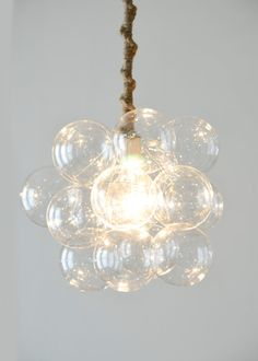 This rounded bubble chandelier is the perfect addition to any room. With eighteen bubbles arranged in a neat ball surrounding a matching globe