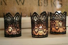 elegant black lace candle holders keep Halloween parties sophisticated while paying homage to traditional Gothic All Hallow's Eve... Halloween Decorations: Bathroom Edition from Bathroom Bliss by Rotator Rod